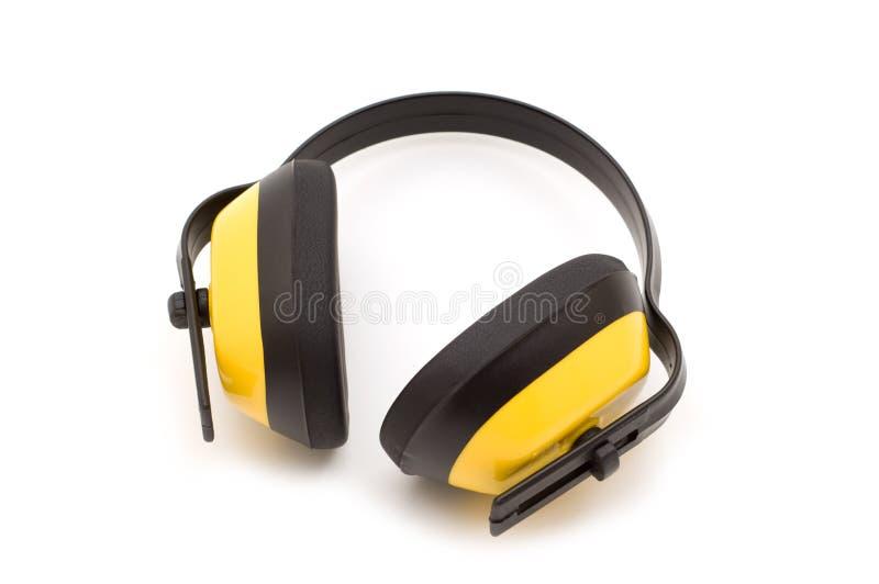 Écouteurs jaunes de protection image libre de droits
