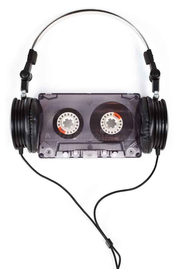 Écouteurs sur la cassette compacte images libres de droits