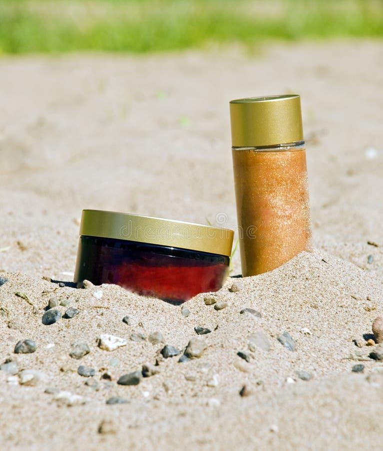 Écrème pour le bronzage photographie stock