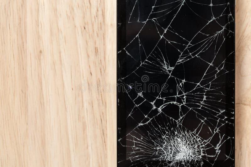 Écran criqué de la photographie noire mobile de vue supérieure en verre de smartphone photos libres de droits