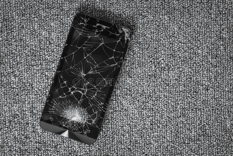 Écran criqué de la photographie noire mobile de vue supérieure en verre de smartphone image stock