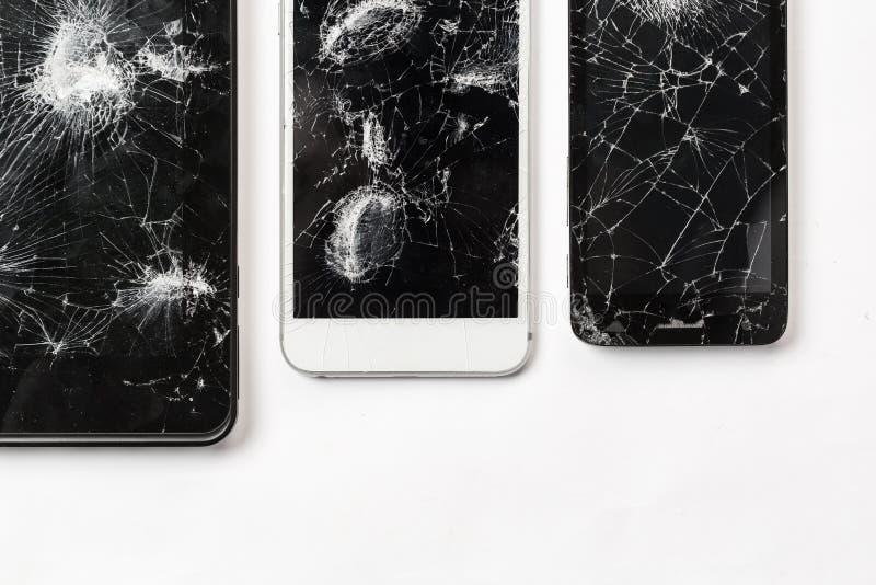 Écran criqué de la photographie noire mobile de vue supérieure en verre de smartphone images stock