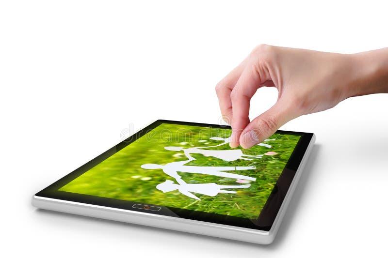 Écran tactile de main sur le PC digital de tablette photos libres de droits