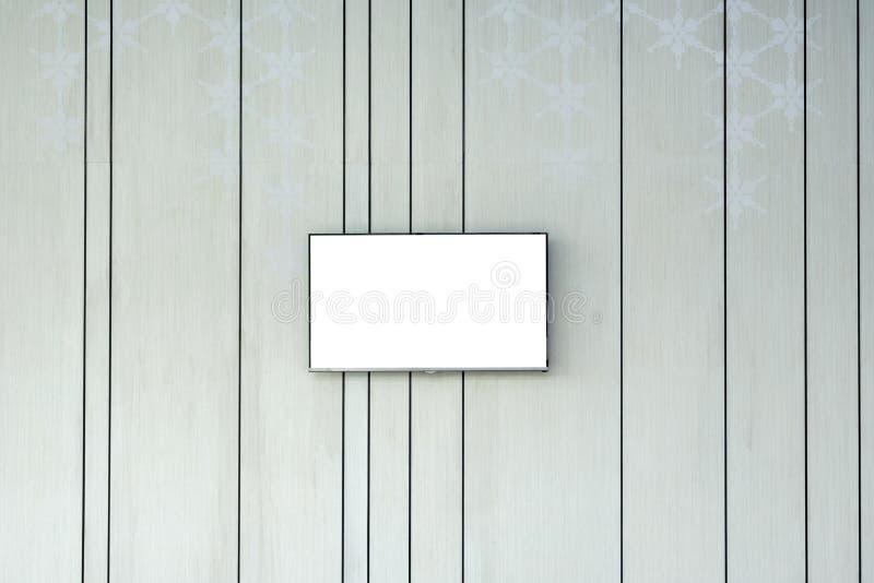 Écran vide plat TV sur le mur décoratif photo libre de droits