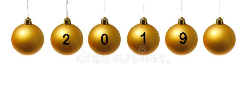 2019 écrit sur les boules d'or de Noël photographie stock libre de droits