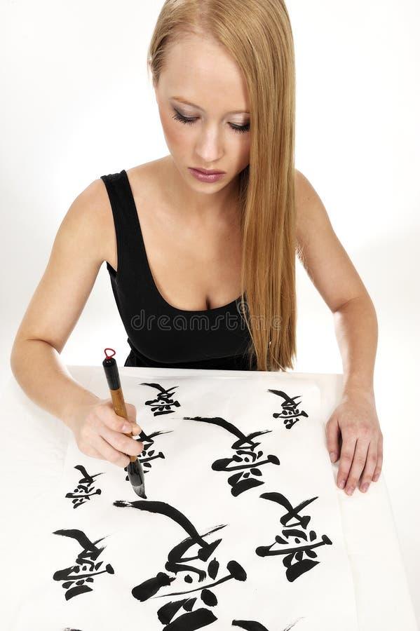 écriture chinoise de femme d'amour de calligraphie photographie stock