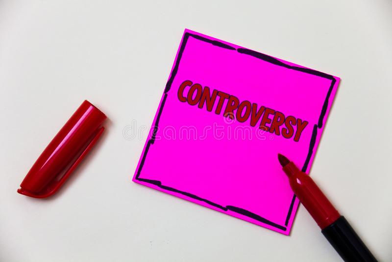 Écriture conceptuelle de main montrant la polémique Désaccord ou argument de présentation de photo d'affaires au sujet de quelque photo libre de droits