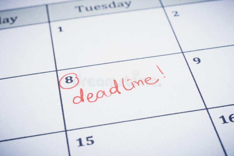 Écriture de date de date-butoir sur le planificateur de chronologie image stock