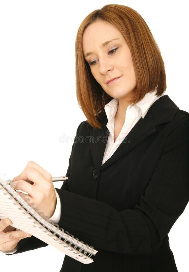 Écriture de femme d'affaires images stock