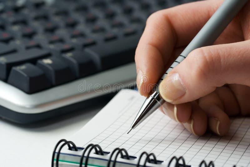 Écriture de femme d'affaires. image stock