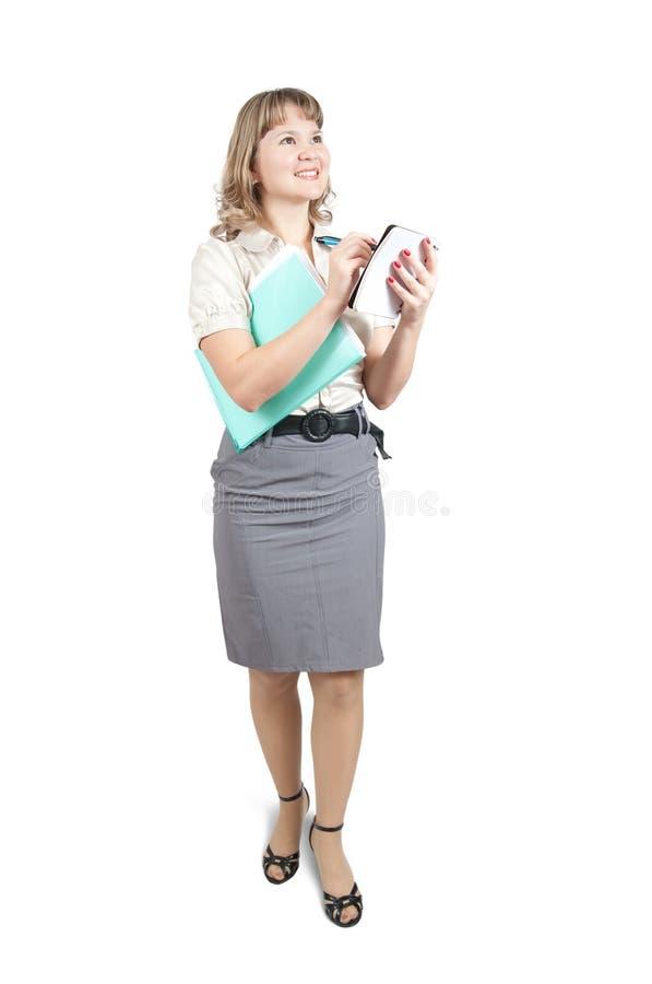 Écriture de femme d'affaires sur son bloc-notes photos stock