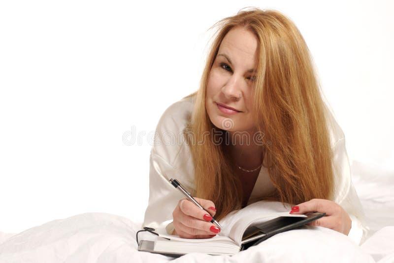 Écriture de femme en tourillon photographie stock