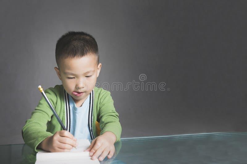 Écriture de garçon photos stock