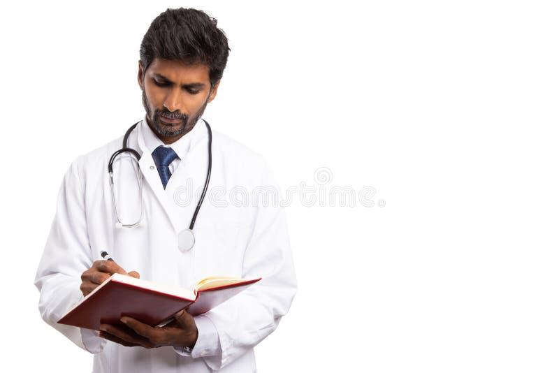 Écriture de médecin à l'ordre du jour image stock