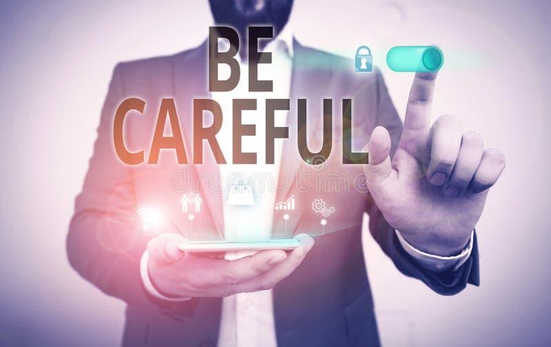 Écriture de texte Soyez prudent Concept d'entreprise visant à éviter les dangers potentiels les malversations ou les préjudices L photos libres de droits