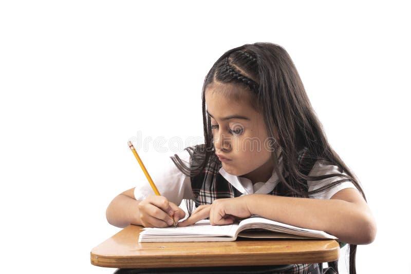 Écriture hispanique de fille à l'école photo libre de droits