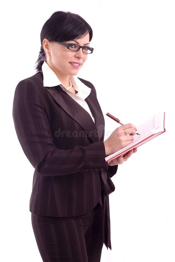 Écriture réussie de femme d'affaires photo stock