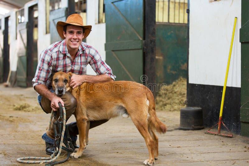 Écuries de chien de cowboy photographie stock libre de droits