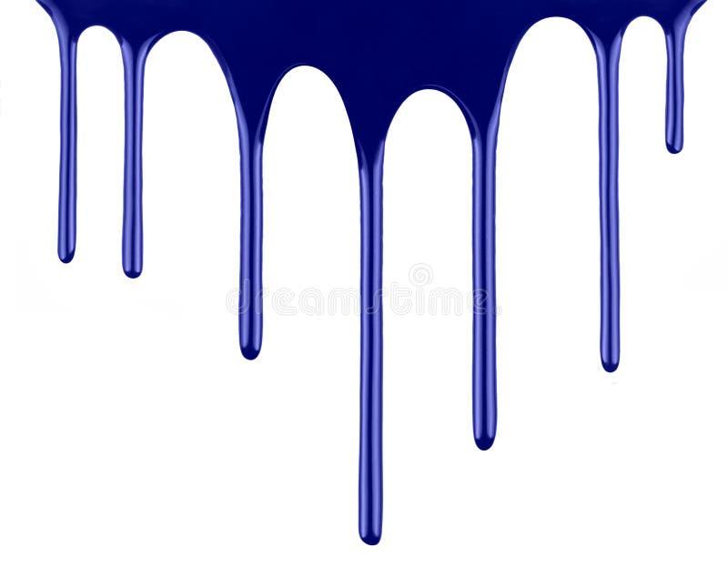 Égoutture bleue de peinture d'isolement au-dessus du blanc photos stock