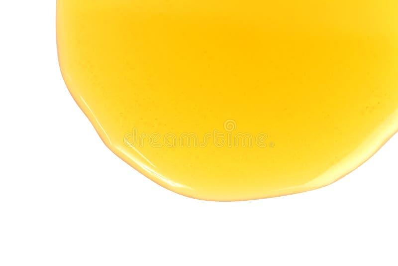 Égoutture d'abeille de miel, miel doux de miel d'isolement sur le foyer sélectif de fond blanc photos stock