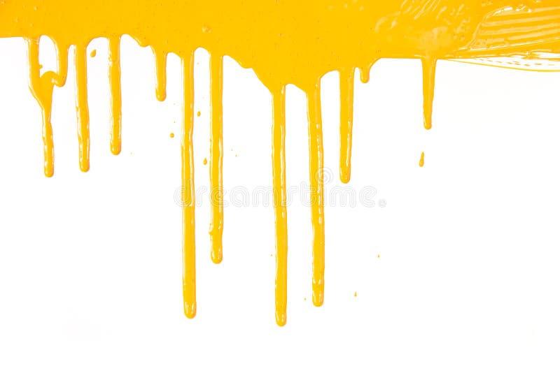 Égoutture orange de peinture/d'isolement sur le blanc images libres de droits