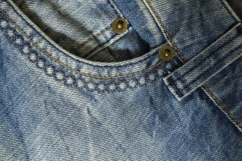 Élément du pantalon de jeans avec la poche avant et le plan rapproché de couture photos stock