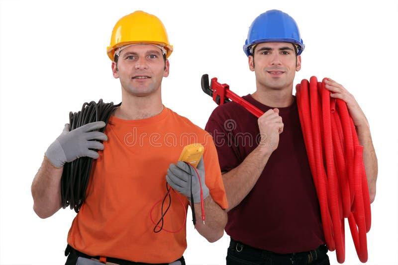 Électricien et plombier images stock