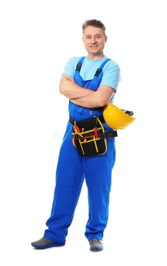 Électricien mûr avec des outils et casque sur le fond blanc photographie stock libre de droits