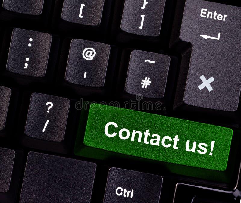 Éntrenos en contacto con en el teclado imagenes de archivo