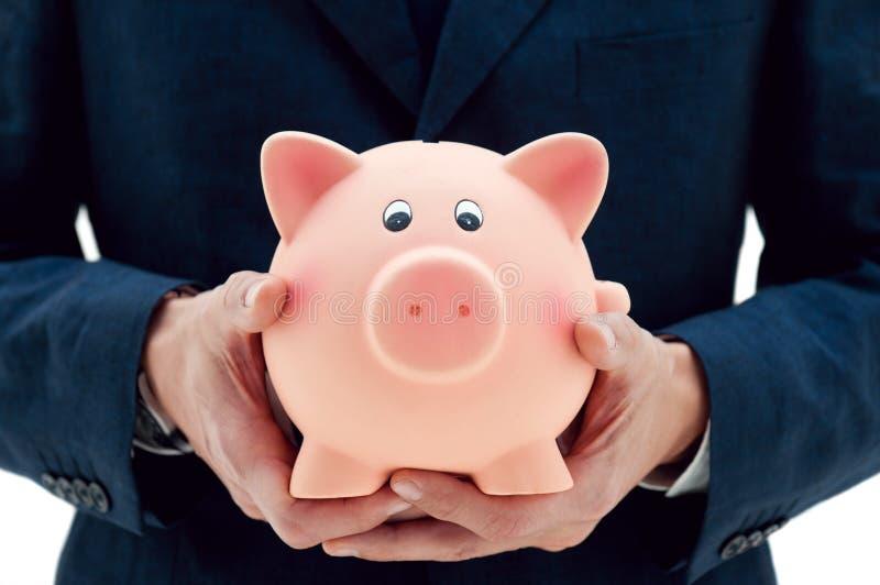 Épargne de votre argent dans les mains droites photo stock