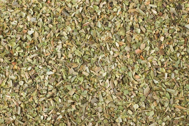 Épice sèche d'origan comme fond, texture naturelle d'assaisonnement image stock
