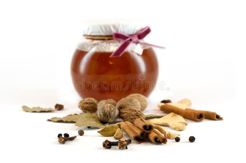 Épices et miel photos stock