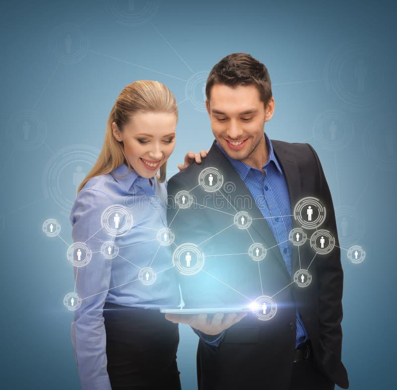 Équipe d'affaires avec le PC de comprimé photos libres de droits
