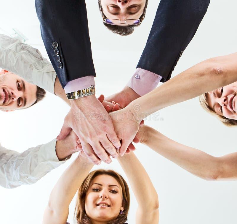 Équipe d'affaires avec leurs mains photo stock