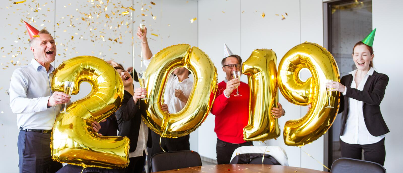 Équipe d'affaires célébrant la nouvelle année images stock