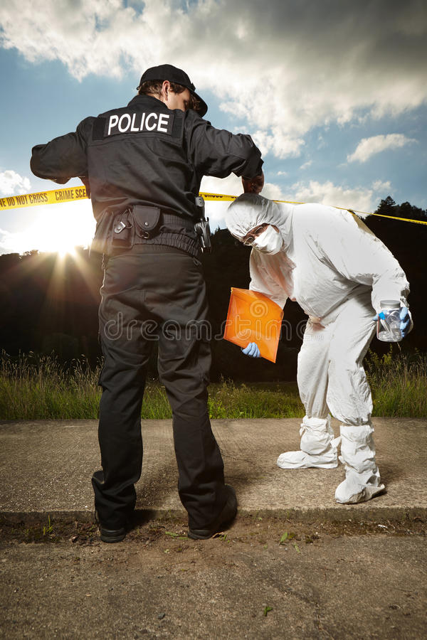 Équipe d'homme et de technicien de police photos stock