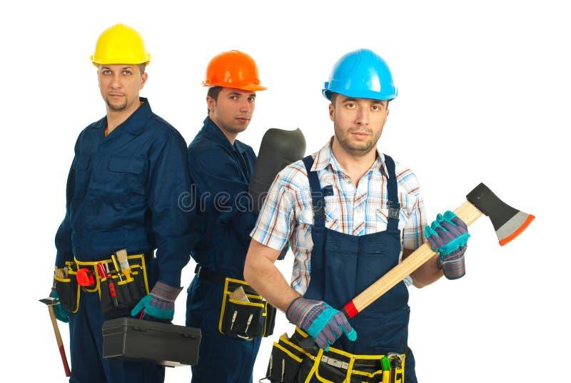 Équipe d'ouvriers de constructeurs photographie stock