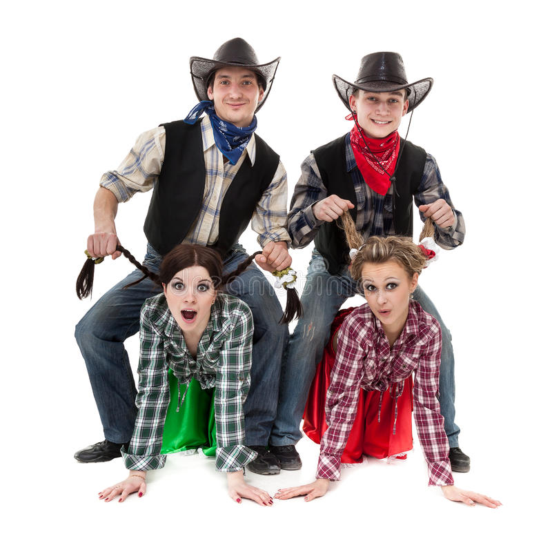 Équipe de danseur de cabaret habillée dans des costumes de cowboy photographie stock libre de droits