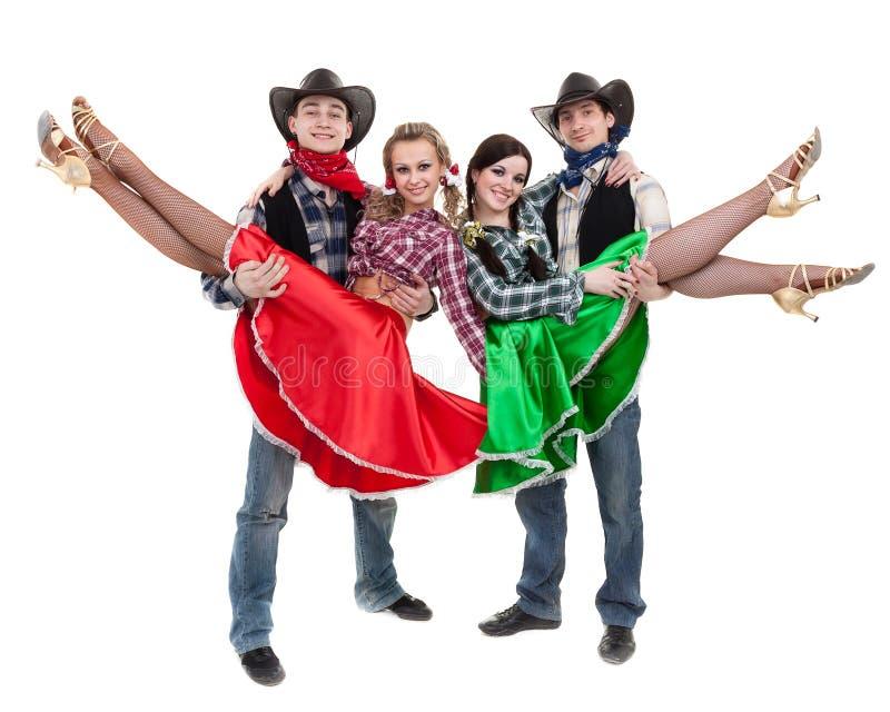 Équipe de danseur de cabaret habillée dans des costumes de cowboy images libres de droits
