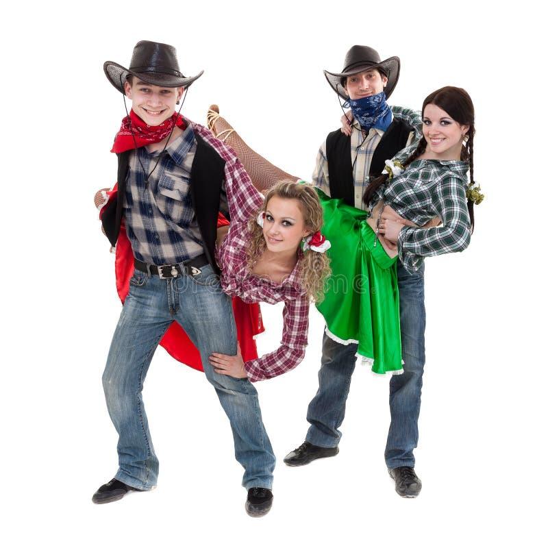 Équipe de danseur de cabaret habillée dans des costumes de cowboy photos stock