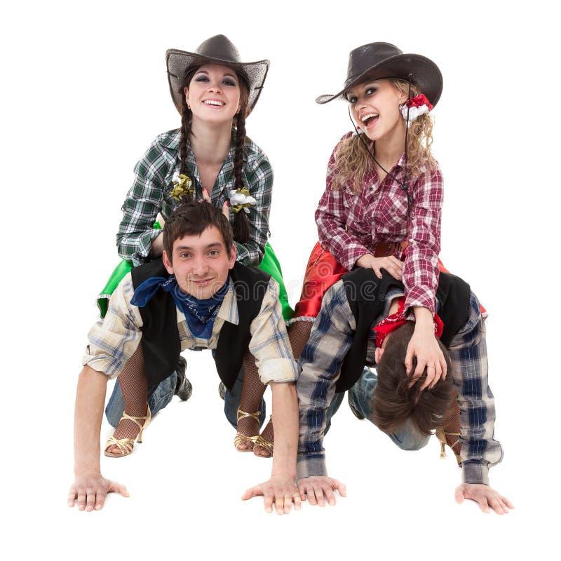 Équipe de danseur de cabaret habillée dans des costumes de cowboy images stock