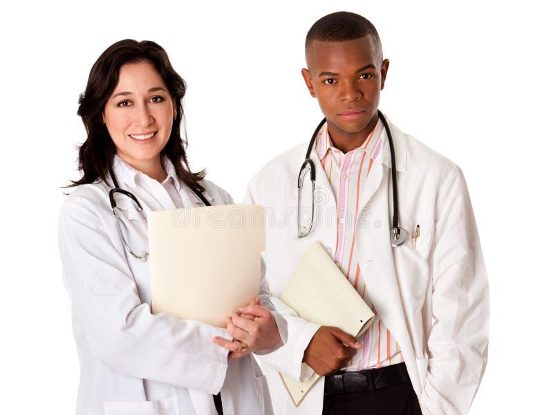 Équipe de docteur avec le dossier patient de fichier image stock