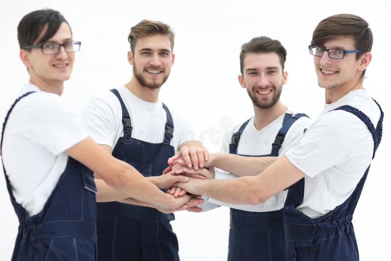 Équipe de moteurs joignant des mains photographie stock libre de droits