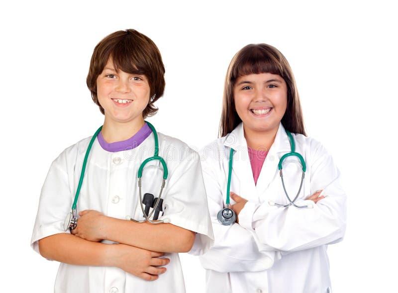 Équipe de petits médecins image libre de droits