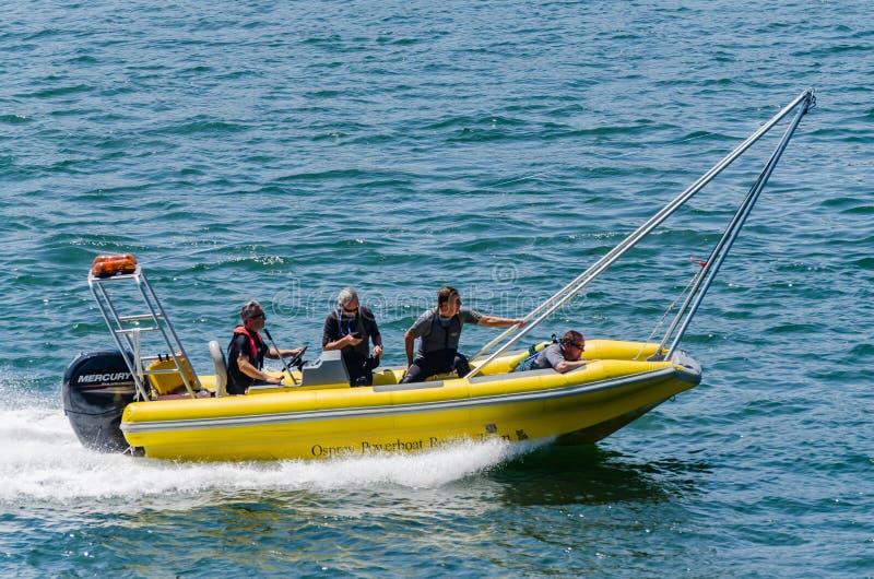Équipe de secours de hors-bord de balbuzard photographie stock libre de droits