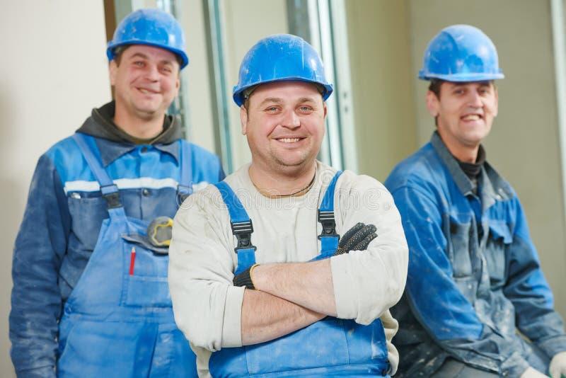 Équipe de travailleurs de la construction photographie stock libre de droits