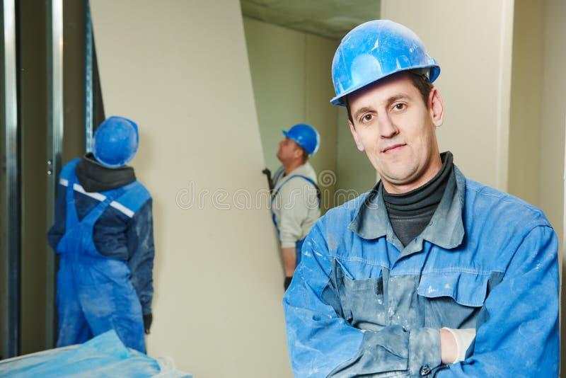 Équipe de travailleurs de la construction photographie stock