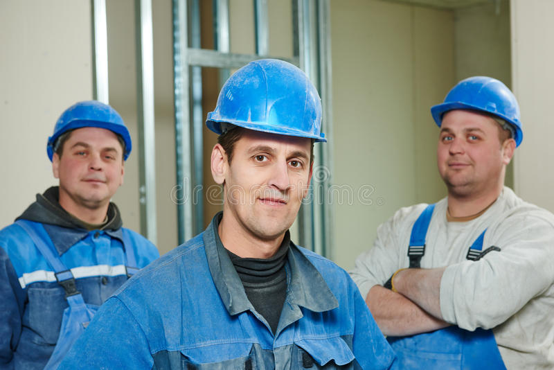 Équipe de travailleurs de la construction photo libre de droits