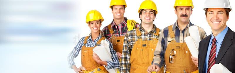 Équipe de travailleurs de la construction photos stock