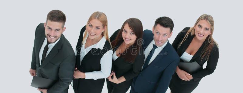 Équipe digne de confiance et professionnelle d'affaires souriant et recherchant photographie stock